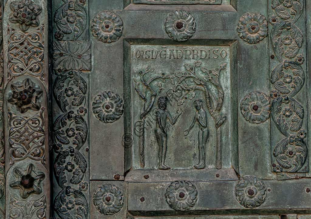 "Monreale Cathedral, the gate by Bonanno Pisano (1185-6): bronze tile depicting ""Adam and Eve in the garden of Eden"" (scene of the Old Testament).The gate is signed ""Bonanno civis pisanus"". It depicts five scenes of the Old Testament at the bottom, starting with Adam and Eve, and five scenes of the New Testament at the top, ending in ""Christ and Mary in the glory of Paradise""."
