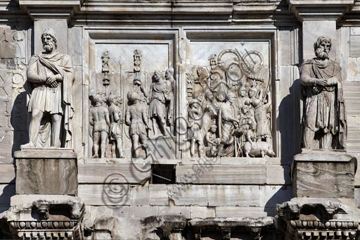 """Rome, Roman Forum, Arch of Constantinus:  Details of Marcus Aurelius reliefs (2nd Century AD.) On the left panel  """"Adlocutio"""", -  the emperor speaking to the troops.On the right panel """"Lustratio"""" , -  the emperor sacrificing a pig, a sheep and a bull (Suovetaurilia)"""