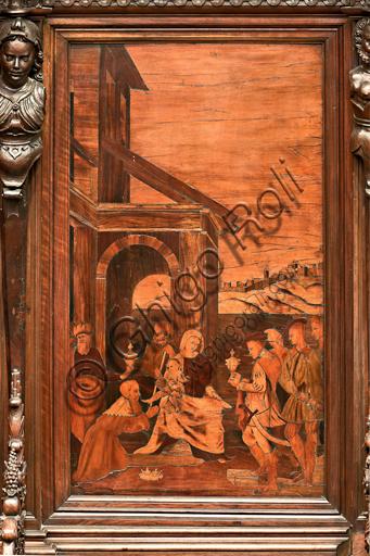 """Genova, Duomo (Cattedrale di S. Lorenzo), interno,  presbiterio, abside, coro, lato sud: """"Adorazione dei Magi"""", tarsia lignea di Gian Michele De' Pantaleoni (secolo XVI)."""