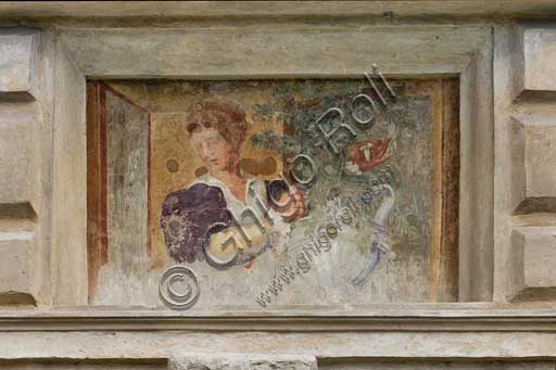 Mantua, Palazzo Te (Gonzaga's Summer residence), Cortile d'Onore (the Courtyard of Honour): detail of a tromp l'oeil fresco on the Northern side which represents a fake window and a girl holding a vase of flowers.
