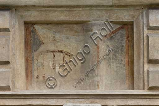 Mantua, Palazzo Te (Gonzaga's Summer residence), Cortile d'Onore (the Courtyard of Honour): detail of a tromp l'oeil fresco on the Northern side which represents a fake window and a bird cage.