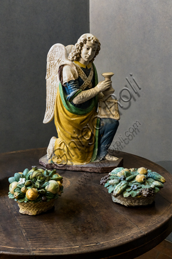 """""""Angel candle holder"""", by Benedetto Buglioni, 1480 - 90, and """"Baskets with flowers and fruit"""", by Giovanni della Robbia's workshop, first quarter of the XVI century,  polychrome glazed terracotta."""