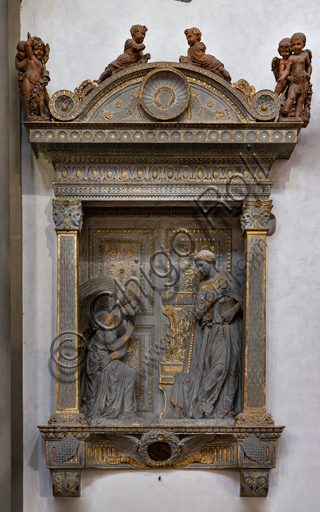 "Basilica of the Holy Cross, right aisle: tabernacle with ""the Cavalcanti Annunciation"", by Donatello, 1433-5, carved in sandstone."