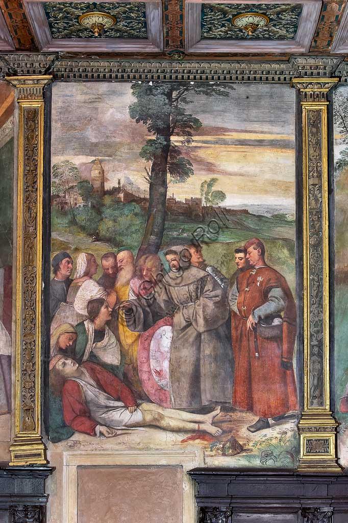 """Padova, Basilica di Sant'Antonio o del Santo, Scuola del Santo, Salone:  """"S. Antonio riattacca il piede al giovane"""", affresco di Tiziano Vecellio."""