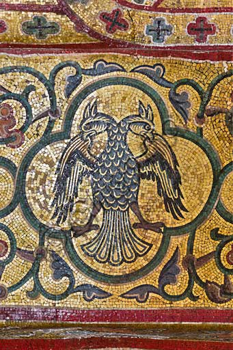 Palermo, The Royal Palace or Palazzo dei Normanni (Palace of the Normans), Pisana Tower,  the King Roger Room (the Room which was commissioned by King Roger II d'Altavilla): decoration of the arch below the vault with mosaics of animals. These mosaics date back to the period of Frederick II.Detail with double headed eagle (emblem of Emperor Frederik II).