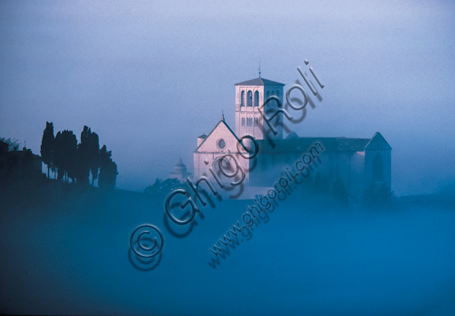 Assisi: Basilica of St. Francis in the morning fog.