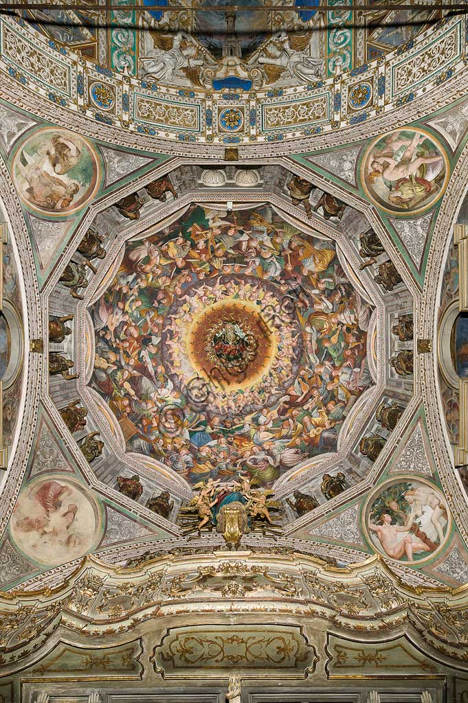 "Saronno, Shrine of Our Lady of Miracles: the dome of the transept with the great fresco ""Assumption of the Blessed Virgin"", known as ""The choir of angels playing music"" painted by Gaudenzio Ferrari from 1534.Paradise is essentially represented by the multitude of angelic presences, placed to crown the face of God and to welcome the arrival of the Virgin.The angels playing music constitute the most varied orchestra of stringed and percussion instruments that has never been painted.Fifty-six different musical instruments can be identified, the most recognizable ones are ancient instruments, the others have been created by  the artist's imagination. The following instruments are recognized: alpenhorn (horn of the Alps), altobasso, harp, bombard, cimballini or small plates, bagpipes, cornet, flute, pan or syringe flute, hurdy-gurdy, lyre, lute, nyastaranga,ribeca, viella, salterio or zither, tambourine , timpani, tr"