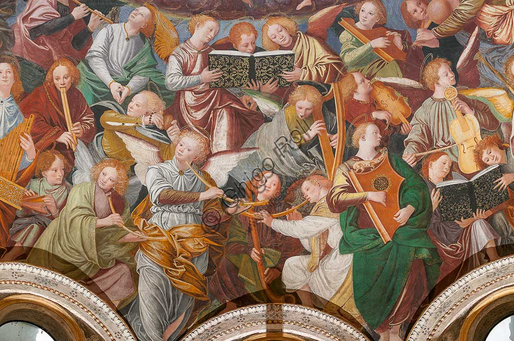 "Saronno, Shrine of Our Lady of Miracles: the dome of the transept with the great fresco ""Assumption of the Blessed Virgin"", known as ""The choir of angels playing music"" painted by Gaudenzio Ferrari from 1534.Paradise is essentially represented by the multitude of angelic presences, placed to crown the face of God and to welcome the arrival of the Virgin.The angels playing music constitute the most varied orchestra of stringed and percussion instruments that has never been painted.Fifty-six different musical instruments can be identified, the most recognizable ones are ancient instruments, the others have been created by  the artist's imagination. The following instruments are recognized: alpenhorn (horn of the Alps), altobasso, harp, bombard, cimballini or small plates, bagpipes, cornet, flute, pan or syringe flute, hurdy-gurdy, lyre, lute, nyastaranga,ribeca, viella, salterio or zither, tambourine"