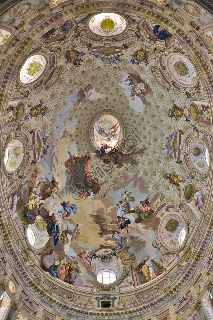 """Sanctuary of Vicoforte: view of the dome with """"The Assumption of Mary"""". Between allegorical scenes (the cardinal Virtues, the Doctors of the Church and adoring angels), the Apostles are present to the glorification of Mary. Cloud and chiaroscuro effects as """"trompe l'oeil"""" create illusionistic effects.Frescoes by Mattia Bortoloni, Felice Biella and Giuseppe Galli Bibiena, 1745-1748.Piemonte - Piedmont, Vicoforte (CN), Santuario di Vicoforte:"""