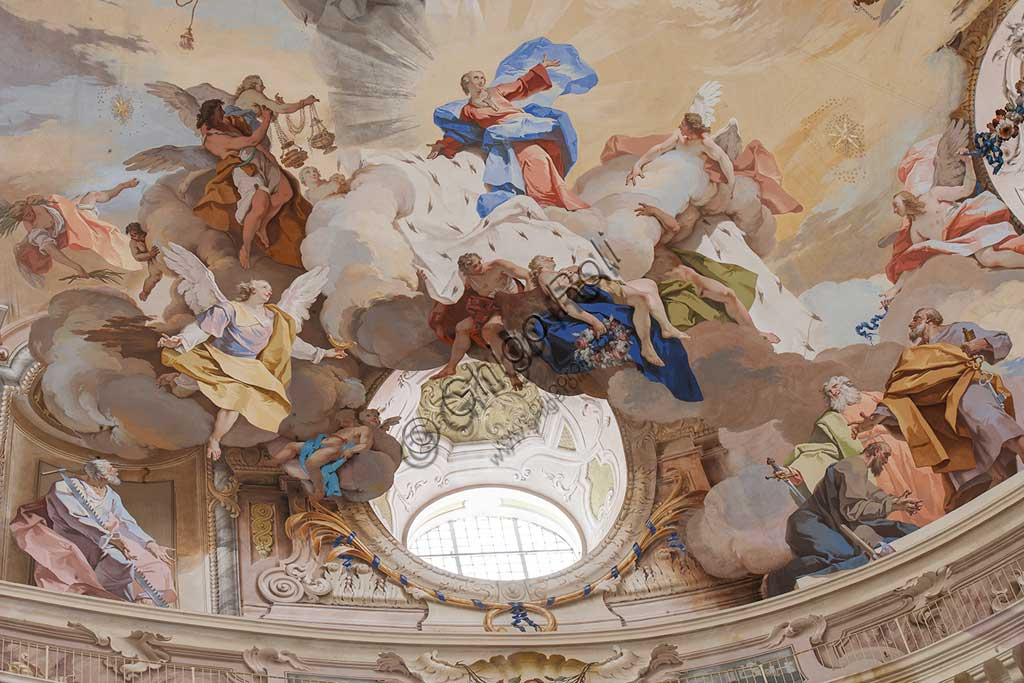 """Sanctuary of Vicoforte: view of the dome with """"The Assumption of Mary"""". Between allegorical scenes (the cardinal Virtues, the Doctors of the Church and adoring angels), the Apostles are present to the glorification of Mary. Cloud and chiaroscuro effects as """"trompe l'oeil"""" create illusionistic effects.Frescoes by Mattia Bortoloni, Felice Biella and Giuseppe Galli Bibiena, 1745-1748.Detail.Piemonte - Piedmont, Vicoforte (CN), Santuario di Vicoforte:"""