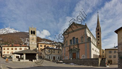 """Bormio, Historical Centre, Cavour or Kuerc Square. Here there are the Kuerc (low loggia with a slate roof where justice was administered and people's assemblies were held), the people's Tower with the """"Baiona"""" (big bell which was rung to to call the council of the region to meeting) and the Collegiate Church dei SS. Gervasio and Protasio."""