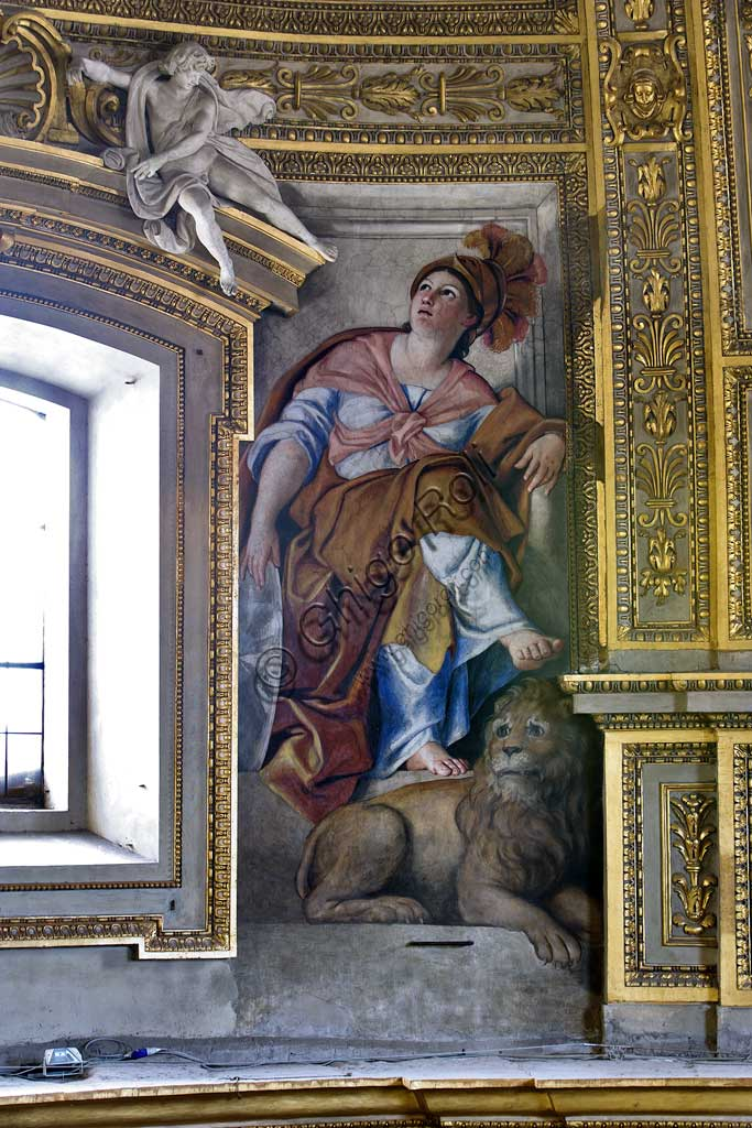 Basilica of St Andrew della Valle, the bowl-shaped vault of the apse: the Fortitude with a lion (one of the six female allegorical figure representing Virtues).  Frescoes realised between the big windows by Domenichino (Domenico Zampieri), 1622 - 1628.