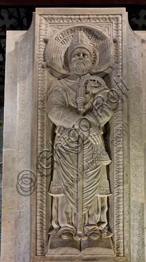 Basilica di San Colombano, cripta, sarcofago di San Colombano, di Giovanni de Patriarchi da Milano (1480): lastra tombale con San Colombano (inizi Novecento).