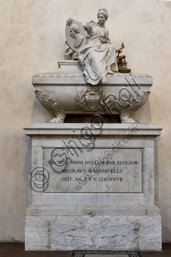 "Basilica of the Holy Cross: ""Monument to Niccolò Machiavelli: Philosopher, Historian, Politician"", by Innocenzo Spinazzi, 1787, marble and bronze.Above the sarcophagus  there is a statue that represents a female figure which is the allegory of politics. In her right hand she holds a medallion with the portrait of Machiavelli, in the left she holds the symbols of Politics, History and Poetry. On the sarcophagus there is the family coat of arms, and on the base a Latin epigraph whose translation i is ""To such a great name, no epitaph is adequate"""