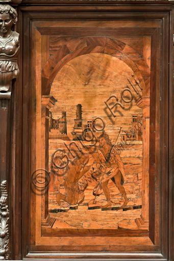 """Genova, Duomo (Cattedrale di S. Lorenzo), interno, abside, coro, lato nord: """"Battesimo di Gesù"""", tarsia lignea di Giovanni Francesco Zambelli (secolo XVI)."""