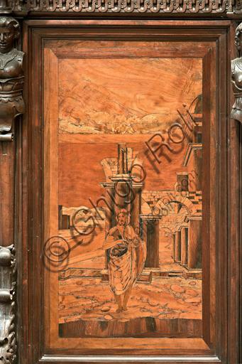 """Genova, Duomo (Cattedrale di S. Lorenzo), interno, abside, coro, lato nord: """"Il Battista nel deserto"""", tarsia lignea di Giovanni Francesco Zambelli (secolo XVI)."""