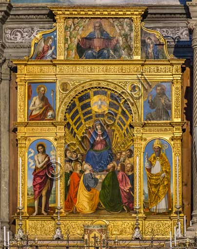"""Bergamo, Church of Santo Spirito:  polyptych made of 8 compartments  """"Madonna sitting on the throne with four Saints, the Eternal Father with Angel and Annunciate, by Bergognone (1515)."""
