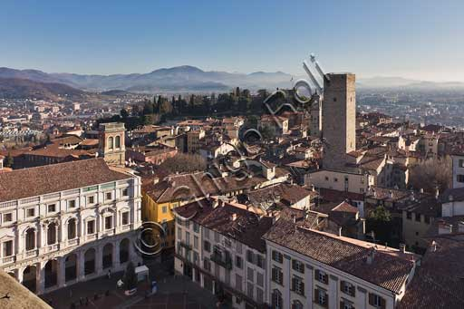 Bergamo, Città alta: view of the town from the Civic Tower, known as the Campanone. On the left, the white façade of Palazzo Nuovo. The tallest tower in the photo is the Gombito tower (1150). In the background, on the left, the Seriana Valley.