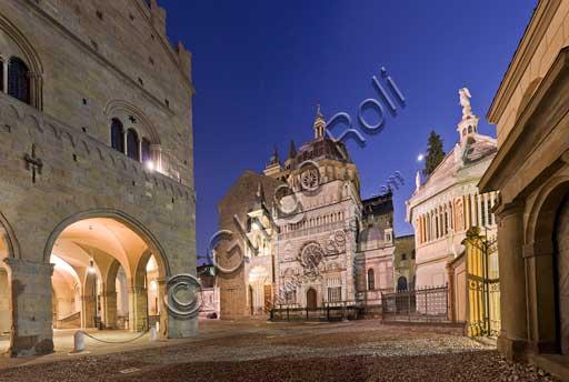 Bergamo, Città alta: night view of  the porch of  Palazzo della Ragione (Ragione Palace). In the background,  the Colleoni Chapel.