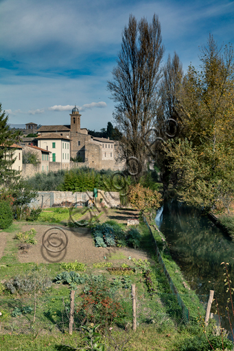 Bevagna: partial view of the town with its walss and the kitchen garden by the river Topino.