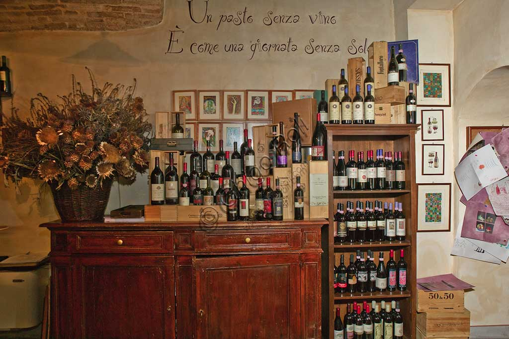 """Bevagna, the """"Bottega Di Piazza Onofri"""", wine shop and restaurant: shelves with bottles of red wine."""