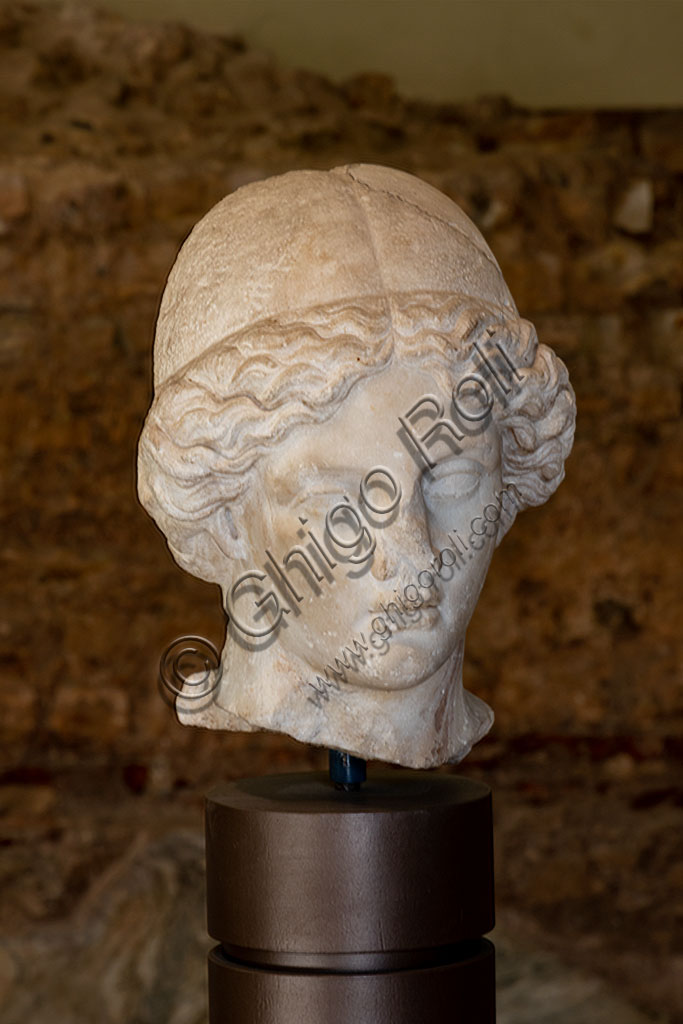 Brescia, the archaeological area of the Capitolium in the ancient Brixia, Unesco heritage since 2011: Head of Minerva, Roman copy of an original Greek artwork (I - II century AD).