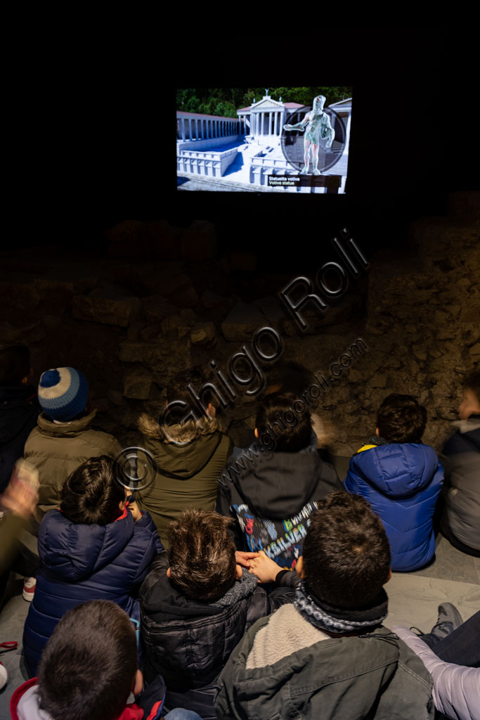Brescia, the archaeological area of the Capitolium in the ancient Brixia, Unesco heritage since 2011, the Sanctuary of the Republican age (I century BC): children of a school group follow an educational film.