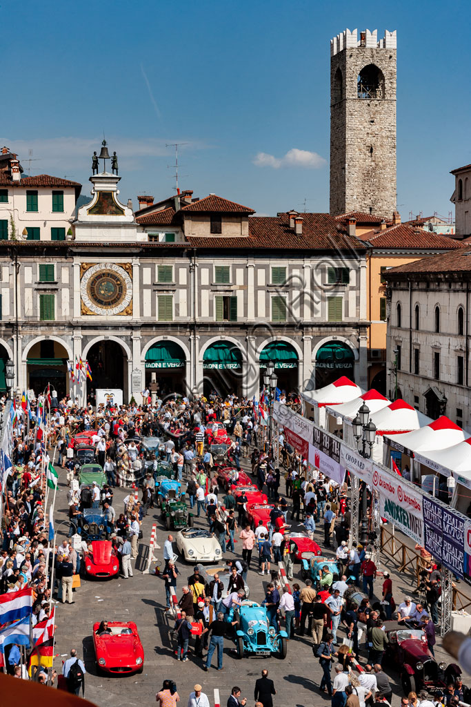 Brescia, piazza della Loggia: the punching before the start of the Mille Miglia, the historic race for vintage cars.