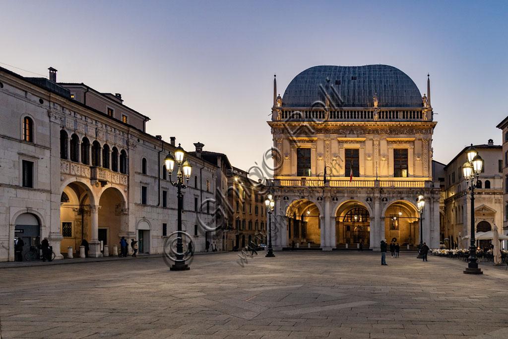 Brescia, piazza della Loggia (a Renaissance square where the Venetian influence is evident):  night view. In the background, the Palazzo della Loggia whose roof and big hall is by Luigi Vanvitelli.