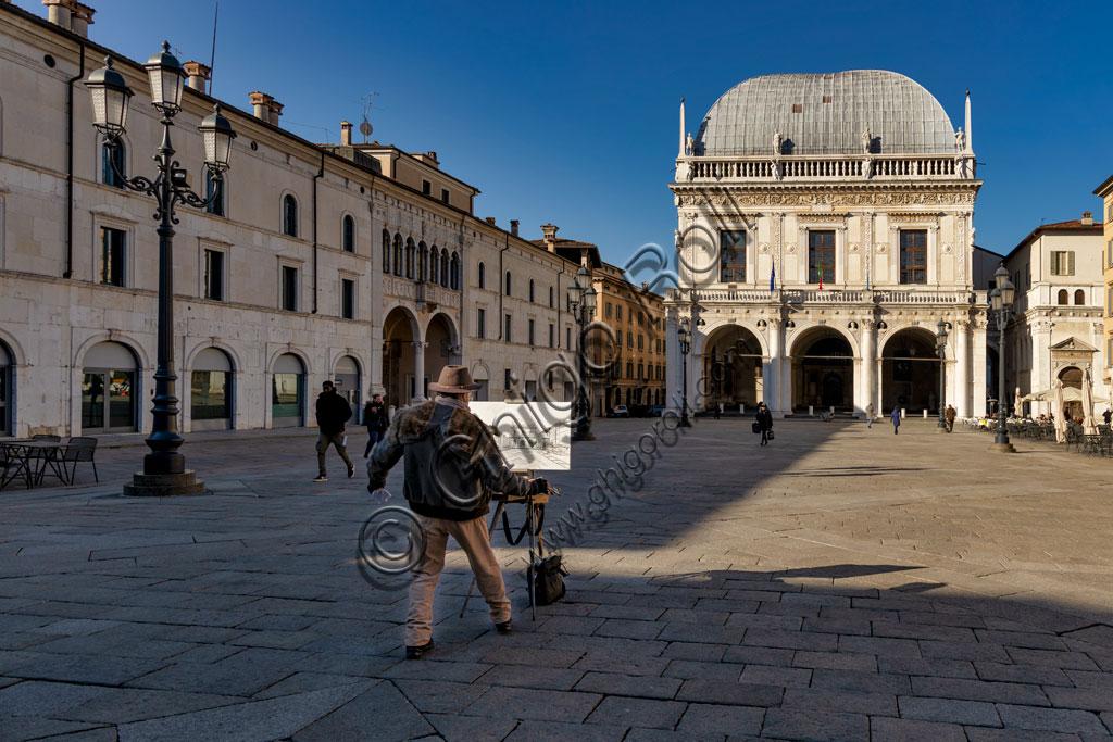 Brescia, piazza della Loggia (a Renaissance square where the Venetian influence is evident): a painter portrays the Palazzo della Loggia.