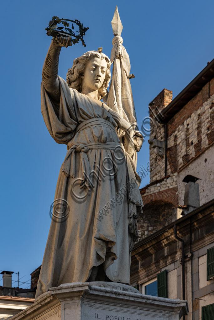 "Brescia, piazza della Loggia (a Renaissance square where the Venetian influence is evident): the marble monument ""Bella Italia or Bell'Italia""  by Giovanni Battista, 1864. Dedicated to the fallen of the Ten Days of Brescia, it was given to the city by Vittorio Emanuele II."