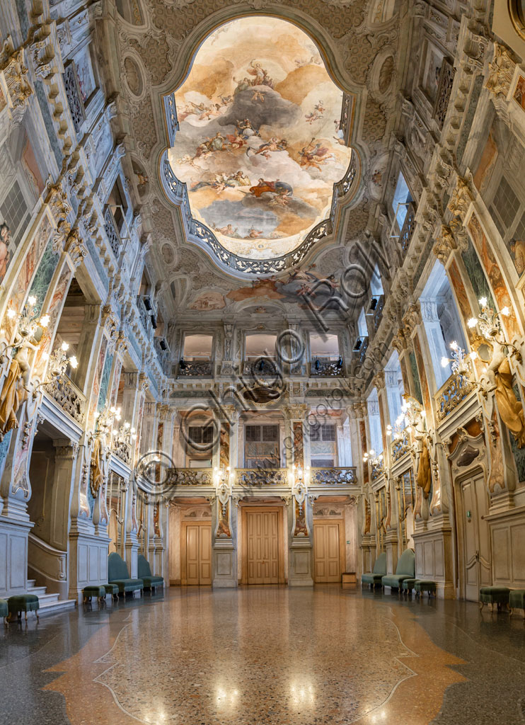 Brescia, Teatro Grande: the Entrance Hall or Foyer. The room is perhaps one of the most admirable examples of 18th-century architectural splendor applied to a theatre. The ornamental decoration was entrusted to the Venetian painters Francesco Battaglioli and Francesco Zugno.