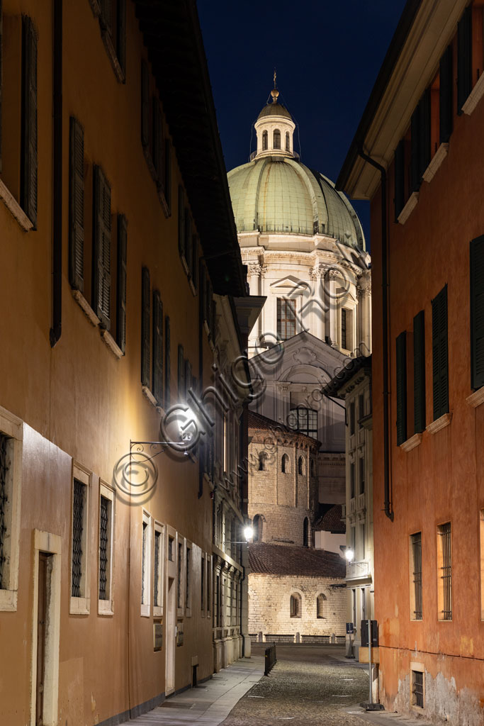 Brescia: night view of the cathedrals. In the background, the Duomo Nuovo  (the New Cathedral) , in late Baroque style with the facade and the dome of Botticino marble. In the foreground, the Duomo Vecchio (Old Cathedral).