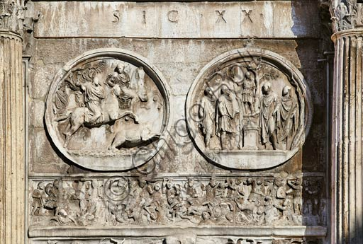 """Rome, Roman Forum: Arch of Constantinus. Detail showing in the left medallion """"Bear Hunting"""", in the one on  the right """"Sacrifice Scene"""", In the lower relief """"The Battle of Ponte Milvio"""". 3rd and 4th Century AD."""