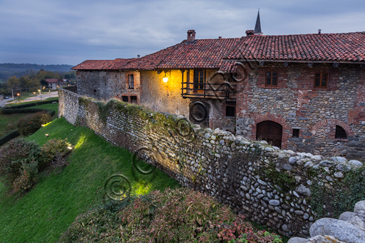Candelo, Ricetto (fortified structure): a night glimpse of the Ricetto with the walls that overlook the Marchesa canal.