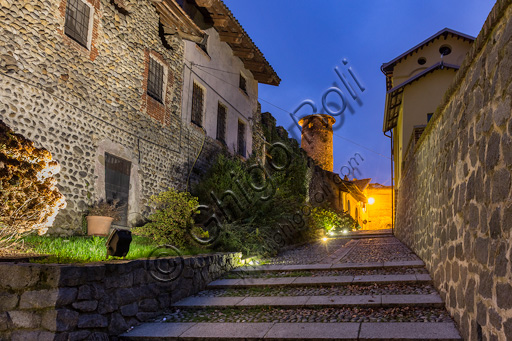 Candelo, Ricetto (fortified structure): a night view of the Lizza street and the  EasternTower.