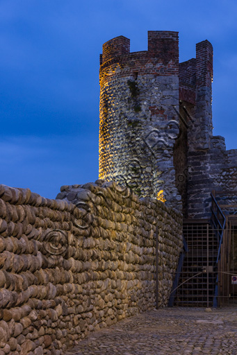 Candelo, Ricetto (fortified structure): a night view of the walls and the South East Tower.