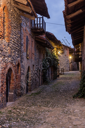 """Candelo, Ricetto (fortified structure): a night view of a """"Rua"""" (street) inside the Ricetto."""