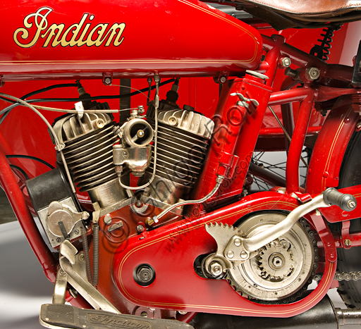 "Vintage motorcycle Indian Powerplus 1000 Side.Brand: Indianmodel: Powerplus 1000 Sidecountry: U.S.A. - Springfieldyear: 1919conditions: restoreddisplacement: 61 ci (987.7 cc. bore and stroke 79.3 x 100)engine: 42 ° V twin cylinder with side valvesgearbox: three-speed with hand controlThe Indian Motorcycle Manufacturing Company is the oldest U.S. motorcycle factory. Founded by George M. Hendee and Carl Oscar Headstrom in 1901, two years before Harley Davidson, it was always on the cutting edge of technology. In 1911 he built four-valve racing engines, in '12 he introduced the rear suspension, in '14 he also provided the electric starter as an option. With the first twin-cylinder Erwin Baker ""Cannonball"" sets ma"