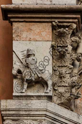 Ferrara, the Cathedral dedicated to St. George, façade detail with knight.