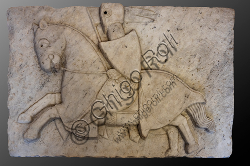 """Spoleto, Rocca Albornoz (Stronghold), National Museum of The Dukedom of Spoleto:""""Knight during a jousting tournament"""", from the ponzianina bridge in Spoleto, by anonymous sculptor, white marble, XIII - XIV centuries."""