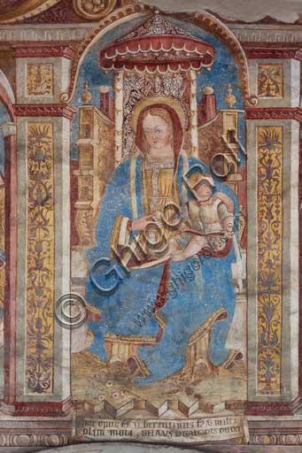 Chiesa di San Defendente, affreschi sotto la lunetta del portale (1483): Madonna in trono con Bambino.