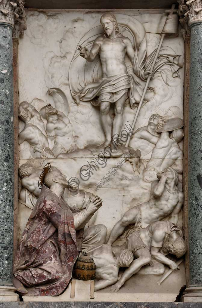 Church of Santa Croce, Mausoleum of St. Pius V: a high-relief in white marble representing  the Resurrection and Pius V in prayer. Based on a design by Giovanni Antonio Buzzi (1568-1571).