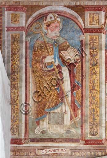Clusone, Chiesa di San Defendente, affreschi sotto la lunetta del portale: San Martino.