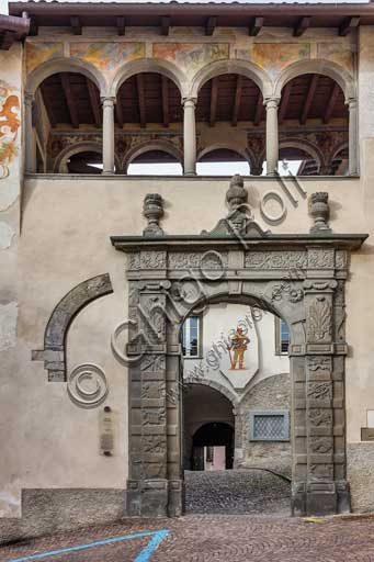 Clusone, Palazzo Comunale (Town Hall), built in the XI and XII century), Eastern Façade: stone portal and a small loggia with frescoes (XVI century).