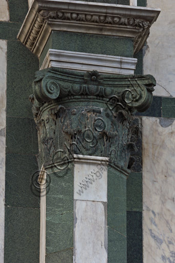 Florence, the Baptistery of St. John, exterior, the Northern façade in Carrara white marble and green Prato marble: detail of a column with capital.