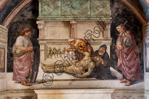 """Orvieto, Basilica Cattedrale di Santa Maria Assunta (o Duomo), interno, Cappella Nova o Cappella di S. Brizio, Cappellina dei Corpi Santi: """"Compianto di Cristo Morto"""" fra i due santi orvietani (S. Parenzo a destra e S. Faustino a sinistra), di Luca Signorelli, 1500 - 1504.di Luca Signorelli 1500 - 1504."""