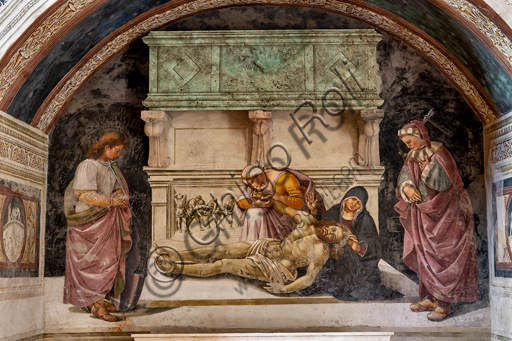 """Orvieto,  Basilica Cathedral of Santa Maria Assunta (or Duomo), the interior, Chapel Nova or Chapel of St. Brizio, Chapel of the Holy Bodies: """"Lamentation of the Dead Christ"""" between the two saints of Orvieto (S. Parenzo on the right and S. Faustino on the left), by Luca Signorelli, 1500 - 1504."""
