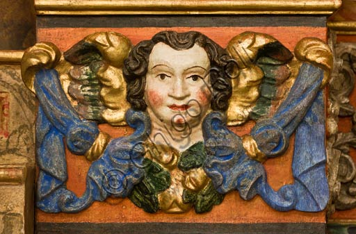 Bormio, Collegiate Church of SS. Gervasio and Protasio: detail of a wooden cornice in a side chapel.