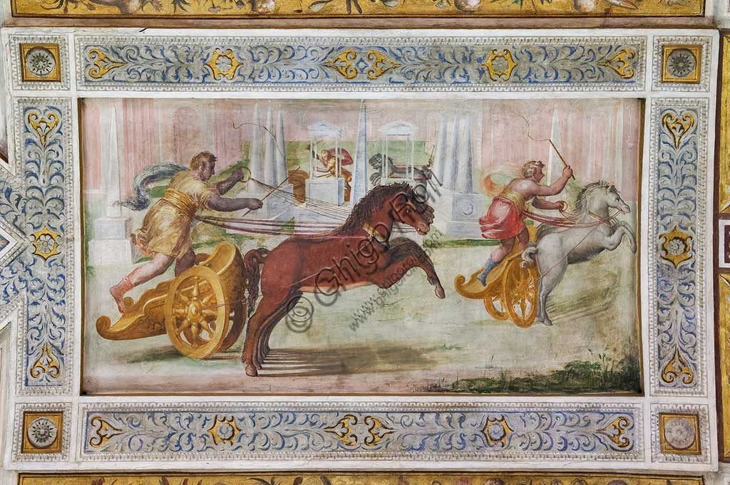 "Ferrara, the Castello Estense (the Estense Castle), also known as Castle of St. Michael: detail of the ceiling of the Hall of Games,""The race of the quadriga"". The frescoes are designed by Pirro Ligorio. The realization  is by Ludovico Settevecchi."